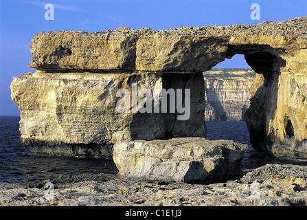 Malta, Gozo Island, natural arch into a cliff - Stock Photo