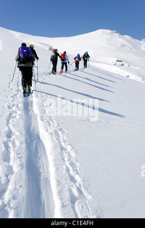 A group of ski tourers in the Silvretta region of Austria - Stock Photo