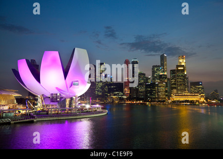 The ArtScience Museum at Marina Bay Sands with city skyline in background.  Marina Bay, Singapore. - Stock Photo