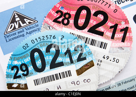 UK DVLA renewal reminder form for renewing road tax disc with old expired and new disc expiring 29th February 2012 - Stock Photo