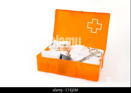 Detail of open first aid kit isolated on white background - emergency  set - Stock Photo