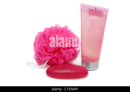 Rose sponge, red soap and tubes helium on white background - Stock Photo