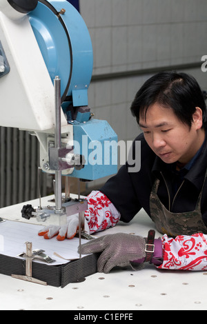 China Garment Factory worker production - Stock Photo