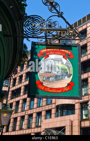 The Railway Tavern Est. 1736 , hanging sign for pub restaurant , once called ' The Cow Shed ' as cattle herded here - Stock Photo
