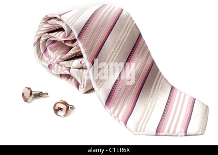 Rose striped tie and cuff links with stone insulated on white background - Stock Photo