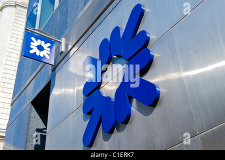 City of London , Royal Bank of Scotland or RBS distinctive logo on wall & hanging sign outside branch - Stock Photo
