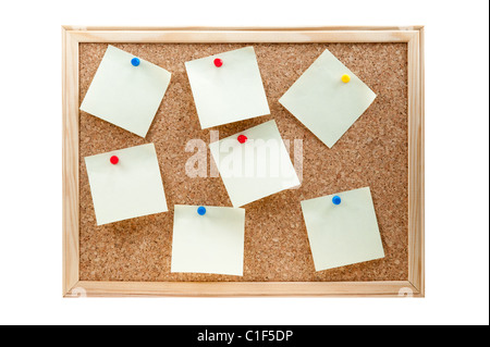 different sticky notes on a cork board isolated on a white background - Stock Photo