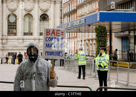 Protesters from CAAT (Campaign Against Arms Trade) demonstrate outside BAE's AGM at the Queen Elizabeth Conference - Stock Photo