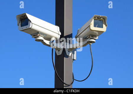 Dual security cameras on a pole - Stock Photo