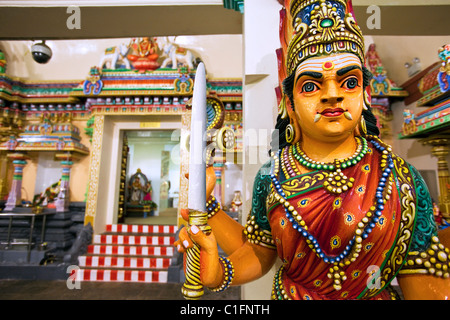 Hindu guardian at the Sri Mariamman Temple.  Chinatown, Singapore - Stock Photo