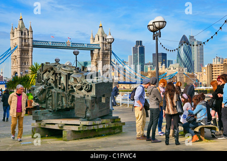 View from Butler's Wharf looking at Tower Bridge and Financial District with Eduardo Paolozzi's 'Head of Invention' - Stock Photo