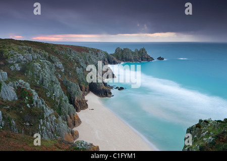 Pednvounder Beach and Logan Rock from Treen Cliff, Porthcurno, Cornwall, England. Autumn (October) 2010. - Stock Photo