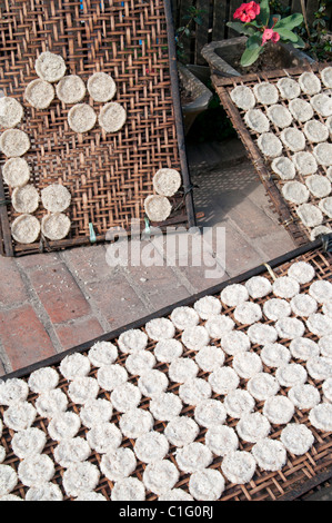 LAOS.RICE CAKES DRYING IN THE SUN IN A VILLAGE BY THE MEKONG RIVER - Stock Photo