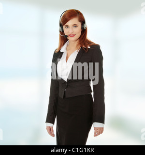 Call center woman with headset. Young businesswoman with headset. - Stock Photo