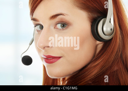 Young businesswoman with headset. - Stock Photo