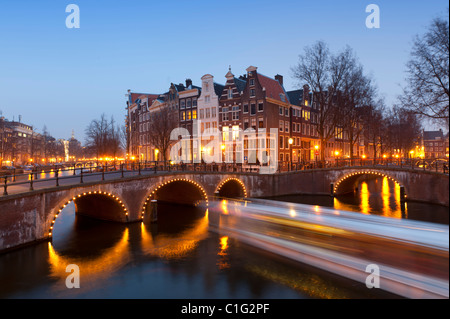 Evening view of bridges crossing the Keizersgracht,canal in Amsterdam The Netherlands - Stock Photo