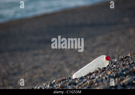 Plastic waste deposited on Chesil beach in Dorset, UK,.  Plastic makes up a large proportion of the litter found - Stock Photo