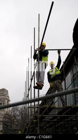 Scaffolders working in London. - Stock Photo