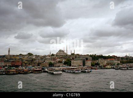 A view over the Golden Horn to Eminonu and the Suleyman Mosque in Istanbul in Turkey in Middle East Asia. Cityscape - Stock Photo