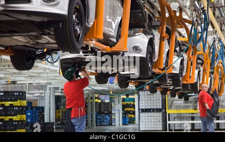 Workers assemble the 2012 Ford Focus at Ford Motor Co.'s Michigan Assembly Plant. - Stock Photo