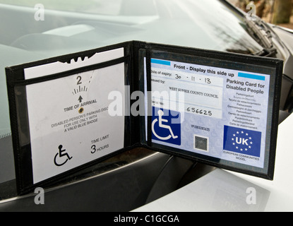 Blue Badge disabled driver parking permit allows UK holders parking privileges. - Stock Photo