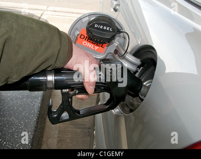 Images of fuel petrol diesel pumps nozzles on forecourt of garage filling station in UK - Stock Photo