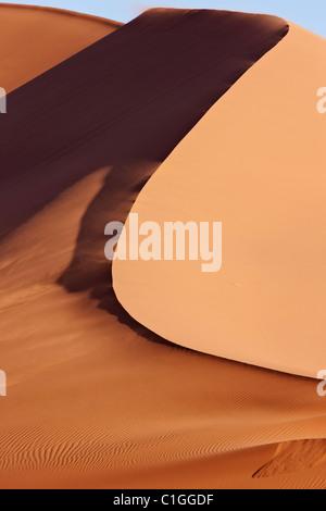 Red sand dunes at Sossusvlei. Namib desert. Namib-Naukluft N.P, Namibia - Stock Photo
