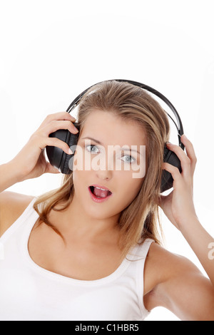 Young woman with headphones - isolated on white - Stock Photo