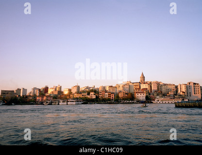 Twilight view of Golden Horn to Karakoy and the Galata Tower of Istanbul in Turkey in Middle East Asia. City Cityscape - Stock Photo