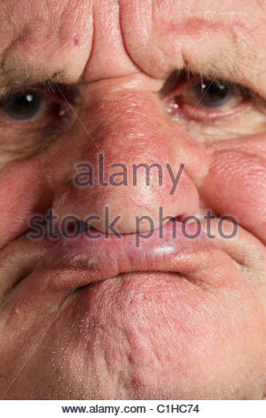 close up of an elderly man without teeth - Stock Photo