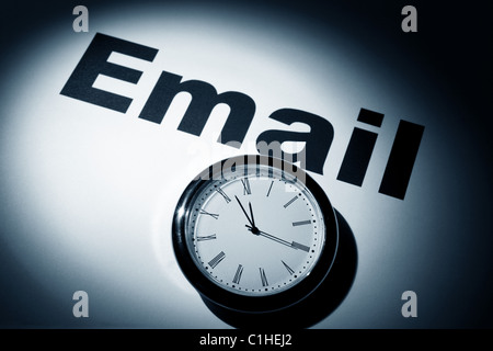 Clock and word of E-Mail for background - Stock Photo
