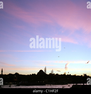 Sunset of the Golden Horn to the Suleyman Suleymaniye Suleiman Mosque of Istanbul in Turkey. Sky Dusk Twilight Dramatic - Stock Photo