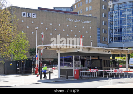 London street scene entrance to BBC Television Centre building with security gatehouse for vehicle exit & entrance - Stock Photo