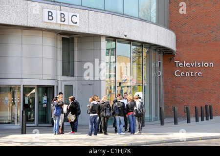London street scene group of people outside entrance to BBC Television Centre building with security bollards White - Stock Photo