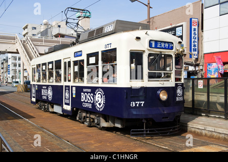 Electric trams form part of the public transport system in Nagasaki, Japan - Stock Photo