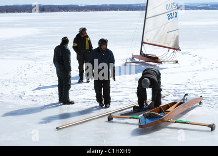 Sailing club members prepare ice boats for sailing on Finger Lakes. - Stock Photo