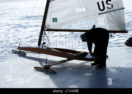 Ice boat being rigged for sail. - Stock Photo