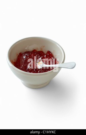 Bowl of Red Pepper Jelly with Spoon - Stock Photo