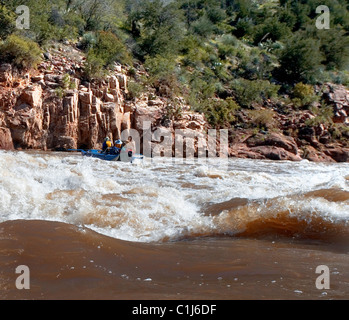 A couple rafting on the Salt River in Arizona, USA on a pontoon boat. - Stock Photo