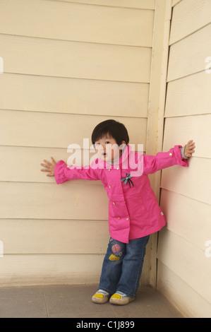 little girl in corner - Stock Photo