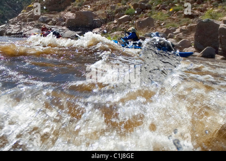 2 couples rafting on the Salt River in Arizona, USA on inflatable pontoon boats. - Stock Photo