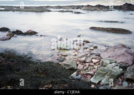 Rising tide on the Seashore, Freshwater West Bay, Pembrokeshire, Wales, UK - Stock Photo