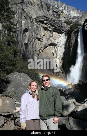Couple at Lower Yosemite Fall in Yosemite National Park - Stock Photo
