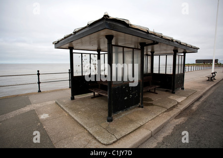 A seaside shelter on the promenade at Hoylake, Wirral, NW UK. This image looks out towards Hoyle Bank - Stock Photo