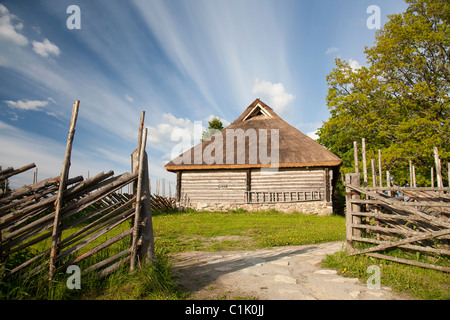 Old Wooden Log Cabin with Thatch Roof, Tammsaare Museum in Järva County, Estonia, Europe - Stock Photo