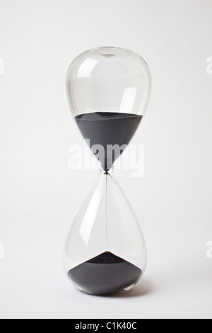 Hourglass black sand timer - Stock Photo