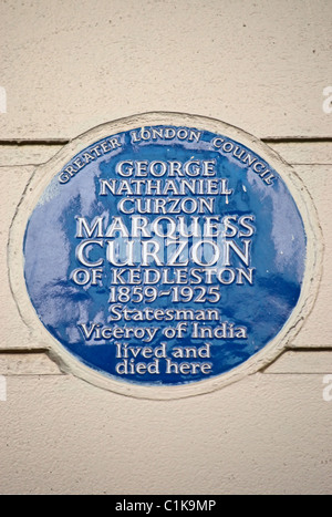 blue plaque marking a home of lord curzon, marquess curzon of kedleston, in carlton house terrace, london, england - Stock Photo