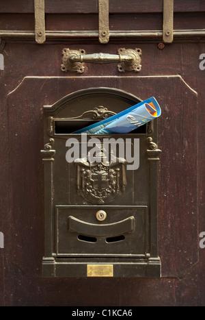 Italian mailbox with mail, Venice, Italy - Stock Photo