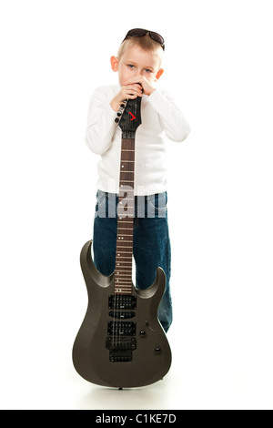 Cute little boy holding a guitar isolated on white - Stock Photo