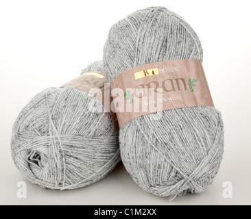 Two 400 gram balls of Hayfield Aran grey wool - Stock Photo